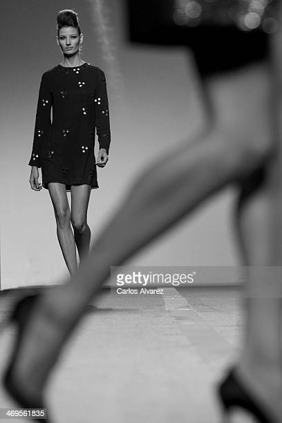 Models showcase designs by Miguel Palacio on the runway at Miguel Palacio show during Mercedes Benz Fashion Week Madrid Fall/Winter 2014 at Ifema on...