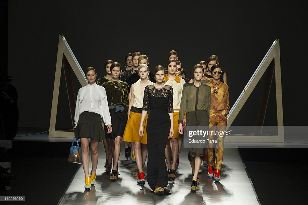 Models showcase designs by Moises Nieto on the runway at the Moises Nieto show during Mercedes Benz Fashion Week Madrid Fall/Winter 2013/14 at Ifema...