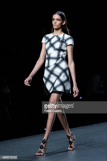 Models showcase designs by Roberto Torreta on the runway during Mercedes Benz Fashion Week Madrid Spring/Summer 2015 at Ifema on September 13 2014 in...