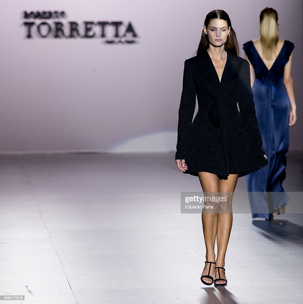 models-showcase-designs-by-roberto-torretta-on-the-runway-at-the-picture-id606171818