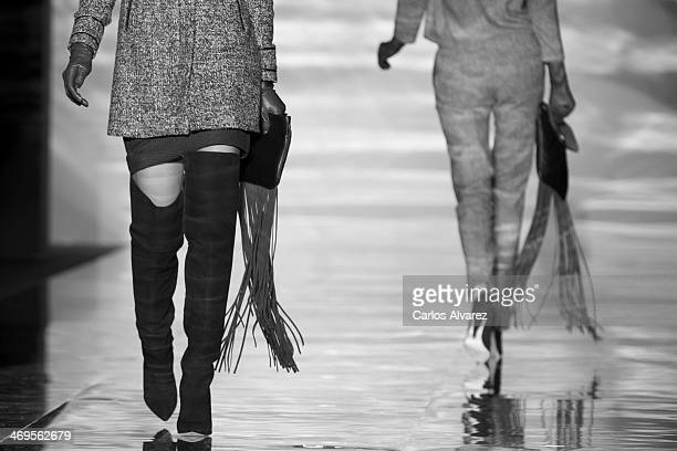 Models showcase designs by Roberto Verino on the runway at Roberto Verino show during Mercedes Benz Fashion Week Madrid Fall/Winter 2014 at Ifema on...