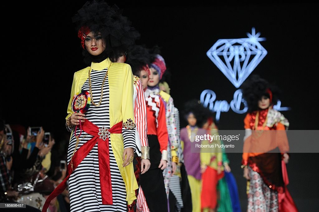 Models showcase designs by Rya Baraba on the runway at the Ebelik Bernah show during Jakarta Fashion Week 2014 at Senayan City on October 25, 2013 in Jakarta, Indonesia.