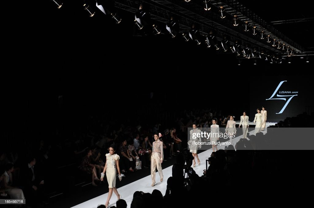 Models showcase designs by students of the Raffles Institute of Higher Education on the runway during Jakarta Fashion Week 2014 at Senayan City on October 21, 2013 in Jakarta, Indonesia.