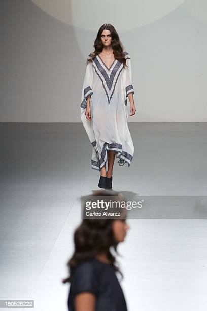Models showcase designs by Teresa Helbig on the runway at Teresa Helbig show during Mercedes Benz Fashion Week Madrid Spring/Summer 2014 on September...