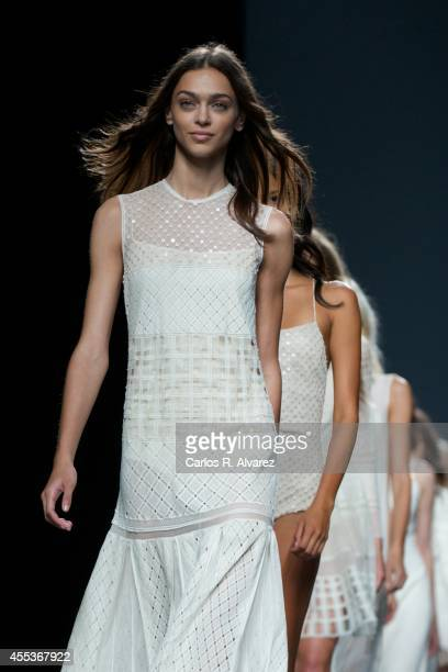 Models showcase designs by Teresa Helbig on the runway at Teresa Helbig fashion show during Mercedes Benz Fashion Week Madrid Spring/Summer 2015 at...