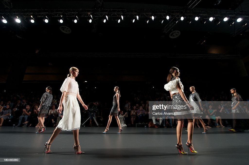 Models showcase designs by Victorio & Lucchino on the runway at Victorio & Lucchino show during Mercedes Benz Fashion Week Madrid Spring/Summer 2014 at Ifema on September 13, 2013 in Madrid, Spain.