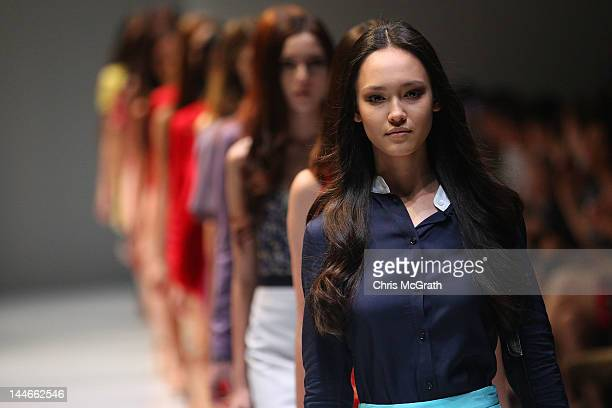 Models showcase designs by YB J'Aime at the Audi Fashion Festival Future Fashion Showcase which featured designs by Timo Weiland Yeojin Bae Esther...