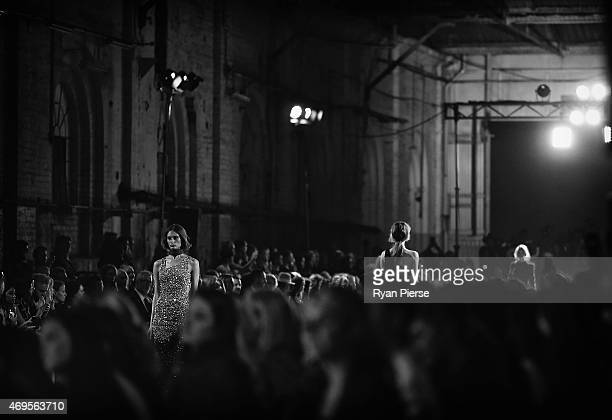Models showcase designs during the Aje show at MercedesBenz Fashion Week Australia 2015 at Carriageworks on April 13 2015 in Sydney Australia