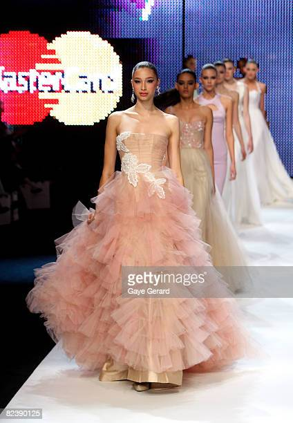 Models showcase designs from Alex Perry's Ready to Wear bridal collection and Safari Princess Spring/Summer collectio at the finale on the catwalk at...