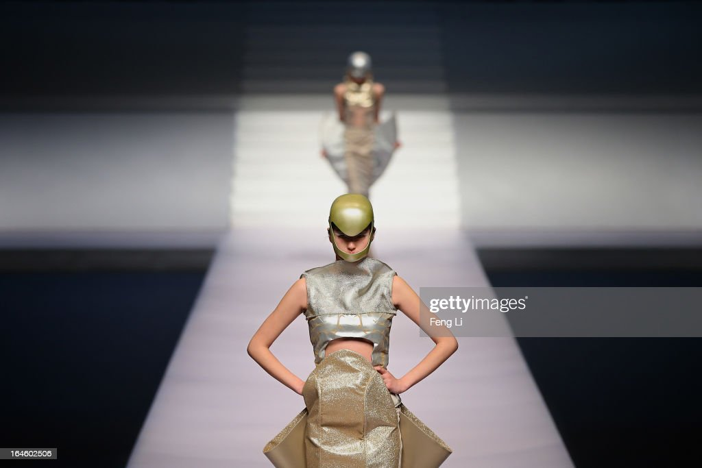 Models showcase designs on the catwalk during Hempel Award the 21st China International Young Fashion Designers Contest on the second day of Mercedes-Benz China Fashion Week Autumn/Winter 2013/2014 at Banquet Hall of Beijing Hotel on March 25, 2013 in Beijing, China.