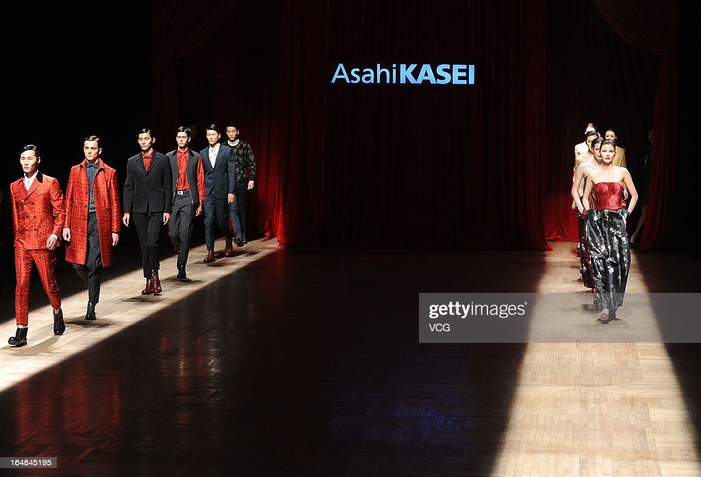 Models showcase designs on the catwalk during the Asahi Kasei Creativity Award Wang Yutao collection show on the fifth day of Mercedes-Benz China Fashion Week Autumn/Winter 2013/2014 at Beijing Hotel on March 28, 2013 in Beijing, China.