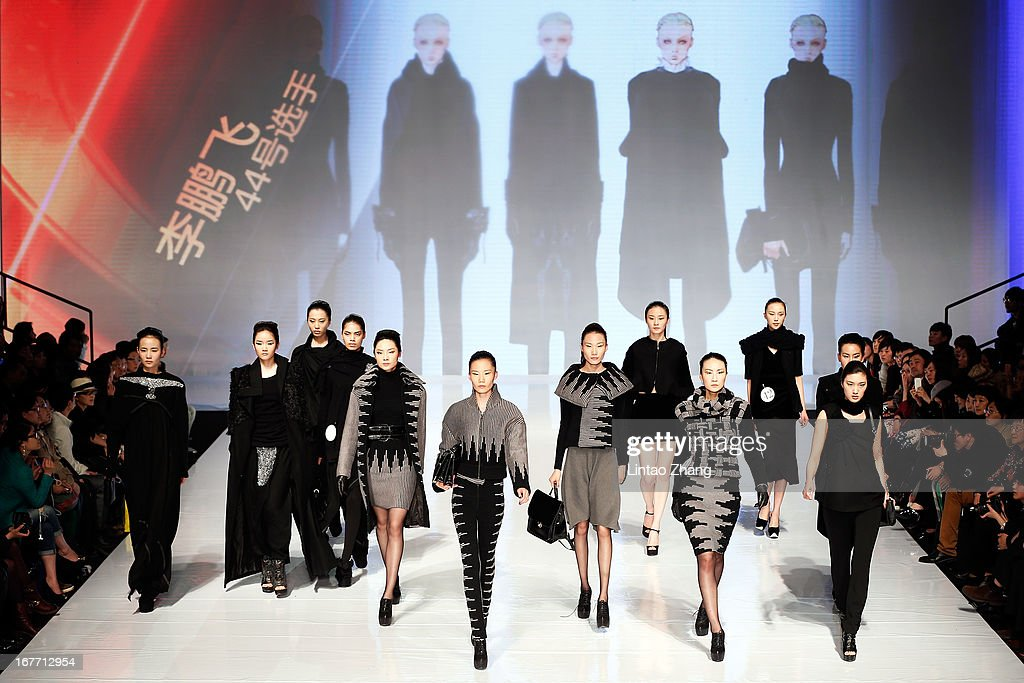 Models showcase designs on the catwalk during the CHERRY the 18th China Excellent Fashion Graduates Award on the Fifth day of China Graduate Fashion Week at 751D.PARK Workshop on April 28, 2013 in Beijing, China.