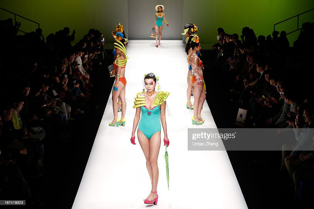 Models showcase designs on the catwalk during the College of Textiles and Garments,Hebei University of Science and Technology Graduates Show on the second day of China Graduate Fashion Week at 751D.PARK Workshop on April 25, 2013 in Beijing, China.