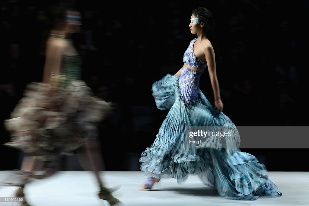 Models showcase designs on the catwalk during the ESMOD Graduate Collection of China Fashion Week Spring/Summer 2013 on October 29, 2012 in Beijing, China.