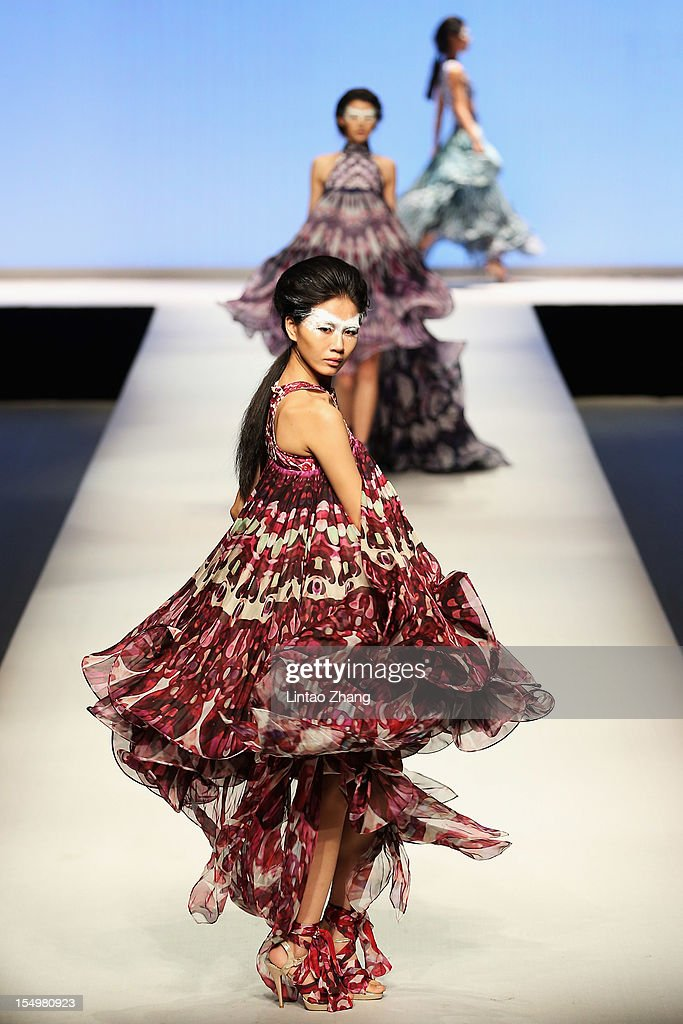Models showcase designs on the catwalk during the ESMOD Graduate collection show of the China Fashion Week S/S Collection 2013 at Beijing Hotel on October 29, 2012 in Beijing, China.