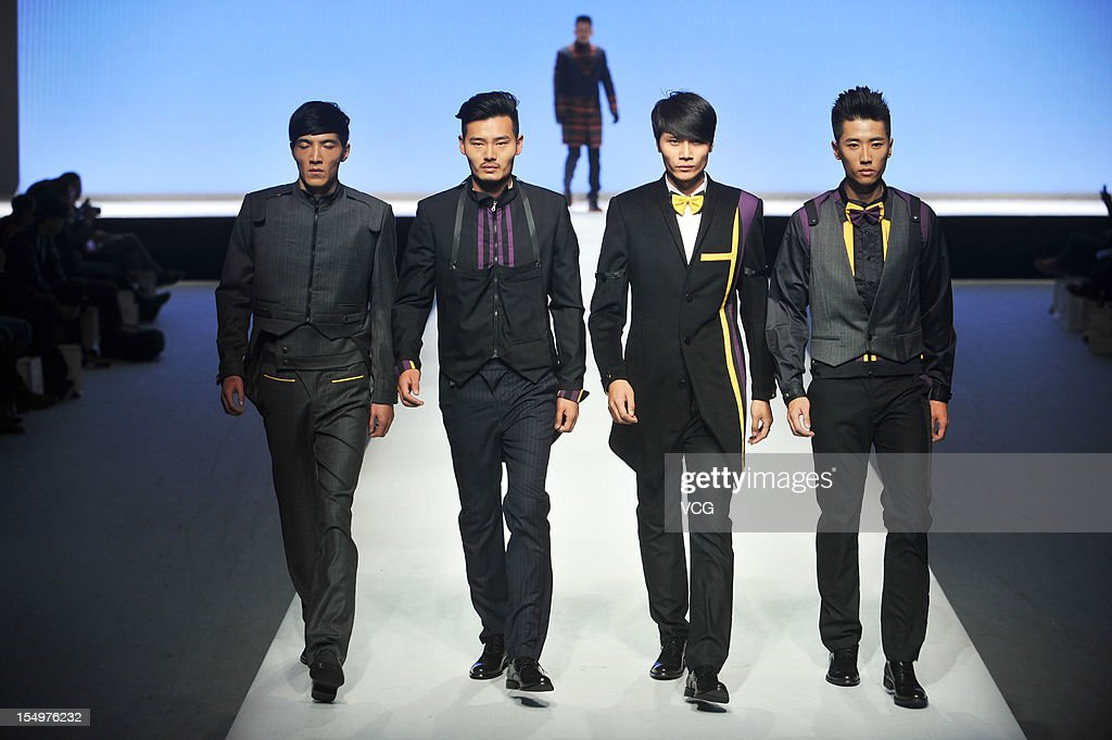 Models showcase designs on the catwalk during the ESMOD Graduate collection show on the fifth day of China Fashion Week S/S Collection 2013 at Beijing Hotel on October 29, 2012 in Beijing, China.