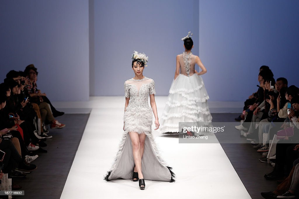 Models showcase designs on the catwalk during the First Master Training Camp Collection Show on the Fifth day of China Graduate Fashion Week at...
