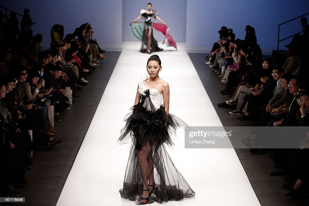 Models showcase designs on the catwalk during the First Master Training Camp Collection Show on the Fifth day of China Graduate Fashion Week at 751D.PARK Central Hall on April 28, 2013 in Beijing, China.