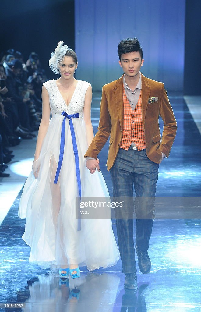 Models showcase designs on the catwalk during the MARK ALPHA OERMA Mark Cheung Wedding Dress collection show on the fifth day of Mercedes-Benz China Fashion Week Autumn/Winter 2013/2014 at 751 D.PARK Workshop on March 28, 2013 in Beijing, China.