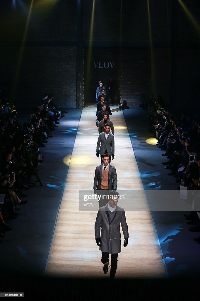 Models showcase designs on the catwalk during the VLOV Wu Qingqing men's collection show on the third day of Mercedes-Benz China Fashion Week Autumn/Winter 2013/2014 at 751 D.PARK Workshop on March 26, 2013 in Beijing, China.