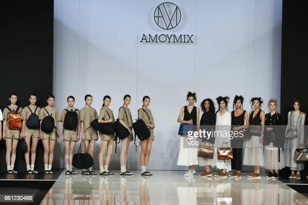 Models showcase designs on the runway at AMOYMIX WOWINGROTTO collection during MercedesBenz China Fashion Week Autumn/Winter 2017/2018 at Banquet...