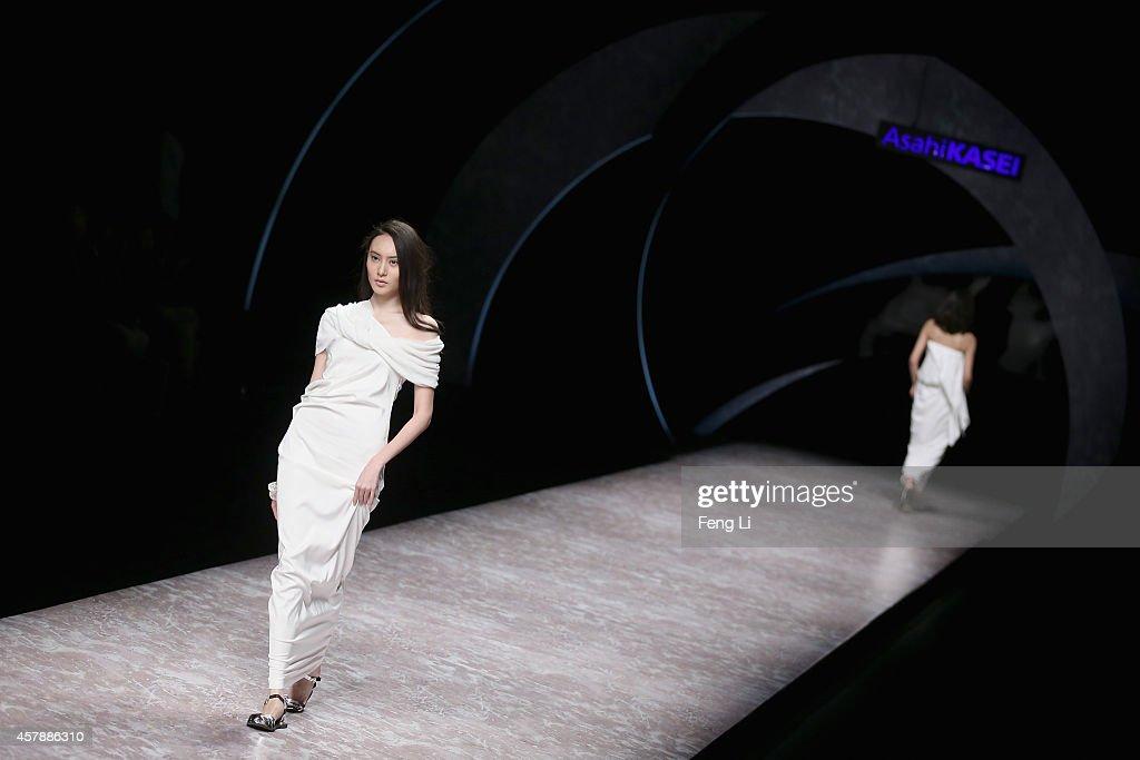 Models showcase designs on the runway at Asahi Kasei Chinese Fashion Designer Creativity Award Hei Lau Collection show during MercedesBenz China...
