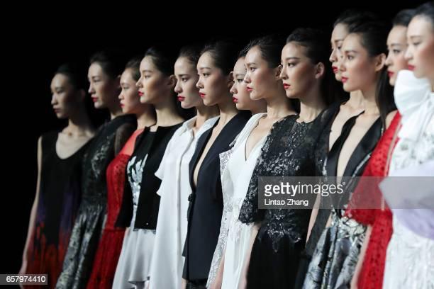 Models showcase designs on the runway at Ashei Kasei Chinese Fashion Designer Creativity Award Tom Dong Show during the MercedesBenz China Fashion...