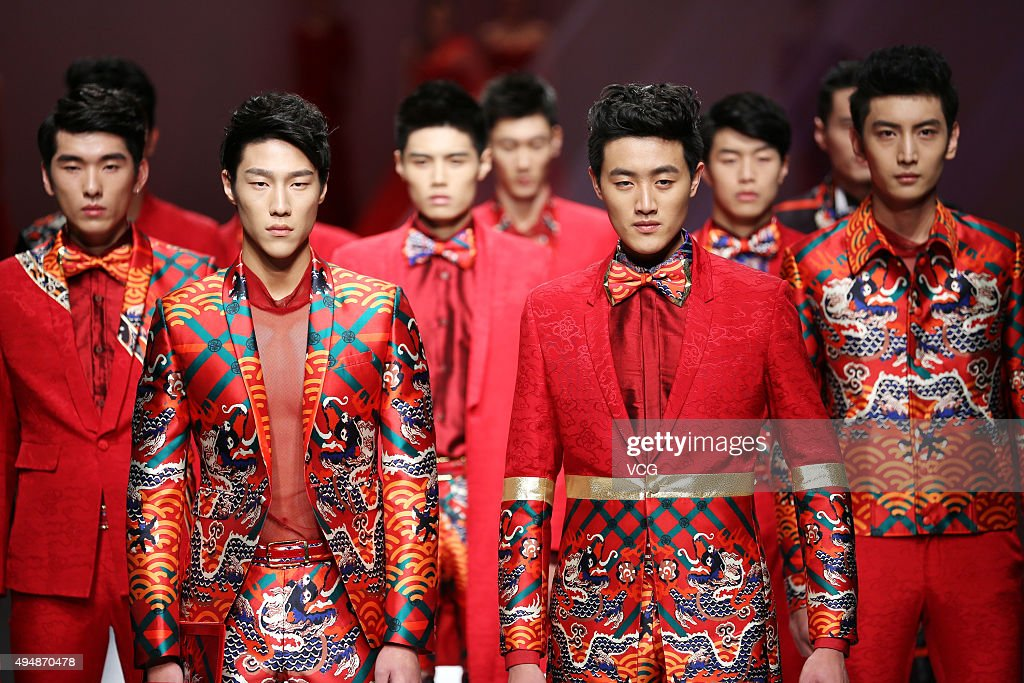 Models showcase designs on the runway at GaryWat Qu Tingnan Collection during the MercedesBenz China Fashion Week Spring/Summer 2016 at Beijing Hotel...