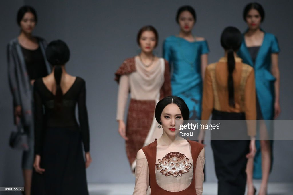 Models showcase designs on the runway at LIANVIS Lian Huiqing Collection show during Mercedes-Benz China Fashion Week Spring/Summer 2014 at 751 D-PARK Central Hall on October 30, 2013 in Beijing, China.
