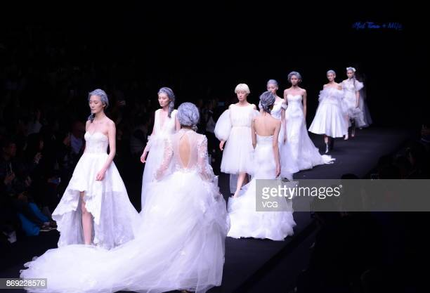 Models showcase designs on the runway at Mid Time Mija Design collection by designer Lv Qing during the MercedesBenz China Fashion Week Spring/Summer...