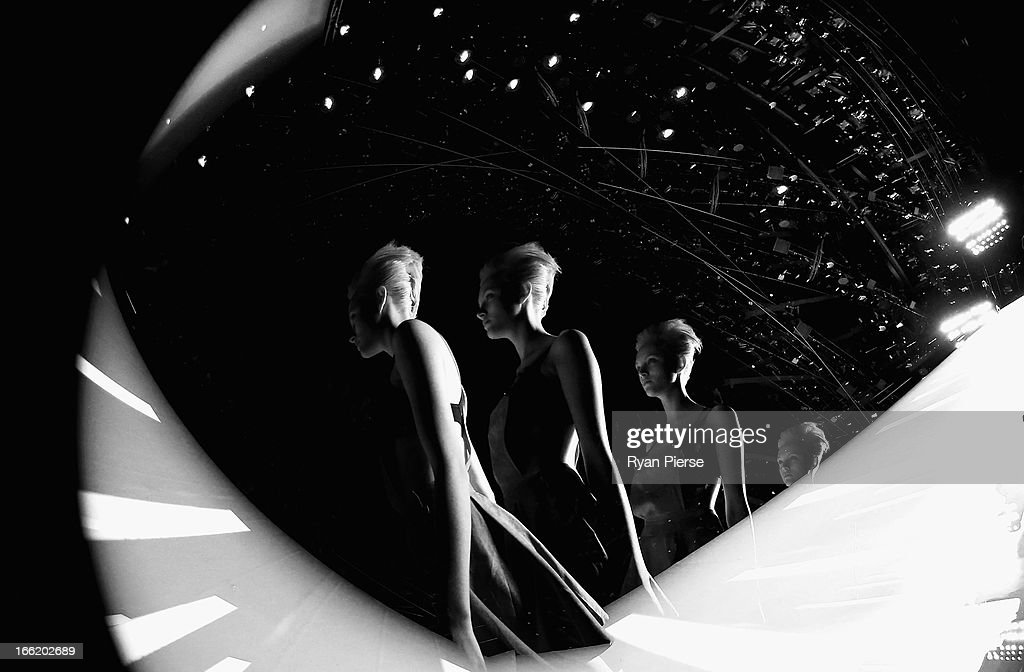 Models showcase designs on the runway at the Easton Pearson show during MercedesBenz Fashion Week Australia Spring/Summer 2013/14 at Carriageworks on...
