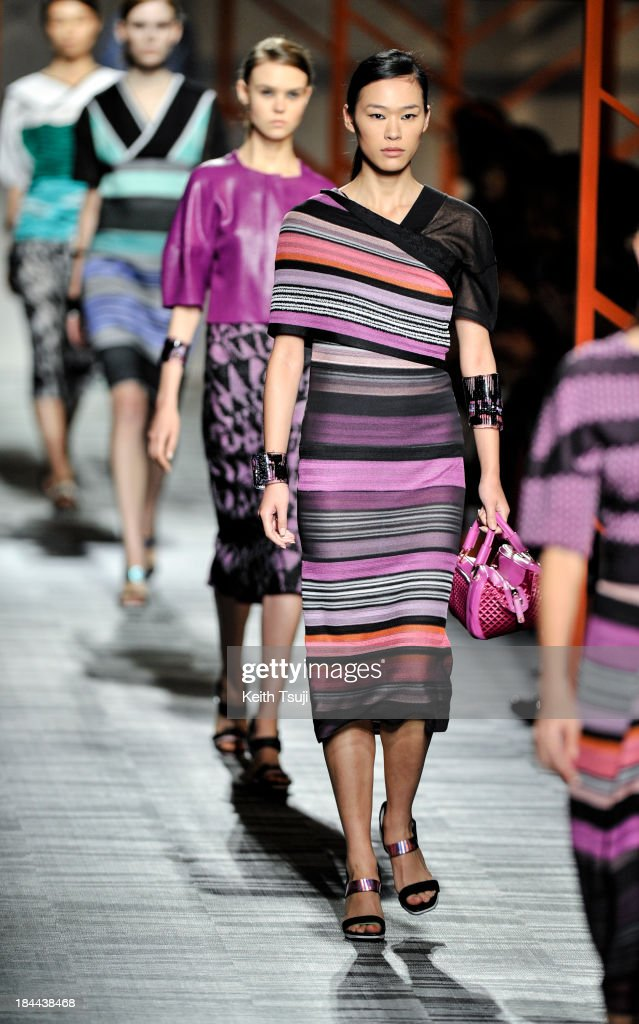 Models showcase designs on the runway during the Missoni show as part of Mercedes Benz Fashion Week Tokyo S/S 2014 at Hikarie Hall A of Shibuya Hikarie on October 14, 2013 in Tokyo, Japan.