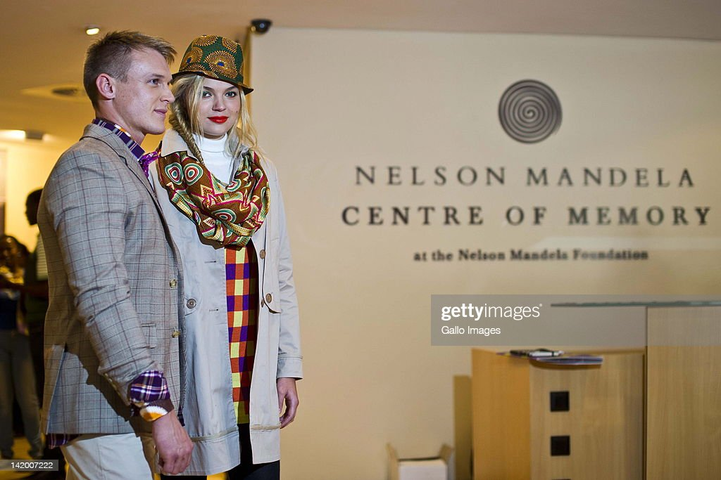 Models showcase new designs at the launch of 46664 Apparel's winter clothing range on March 28, 2012 in Johannesburg, South Africa. Designer Craig Native drew his inspiration from the Nelson Mandela Foundation Centre of Memory's archives of speeches and artifacts.