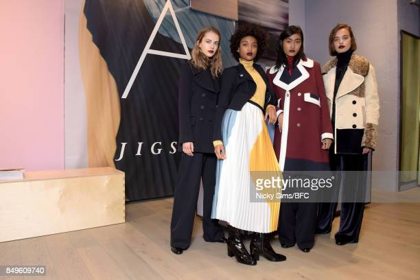 Models showcases designs at the A By Jigsaw presentation during London Fashion Week September 2017 on September 19 2017 in London England
