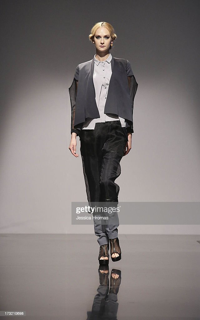 A models showcases designs by dezsilgncedsby on the runway during the Maco Fashion Parade on day 3 of Hong Kong Fashion Week Spring/Summer 2013 at the Hong Kong Convention and Exhibition Centre on July 10, 2013 in Hong Kong, China.