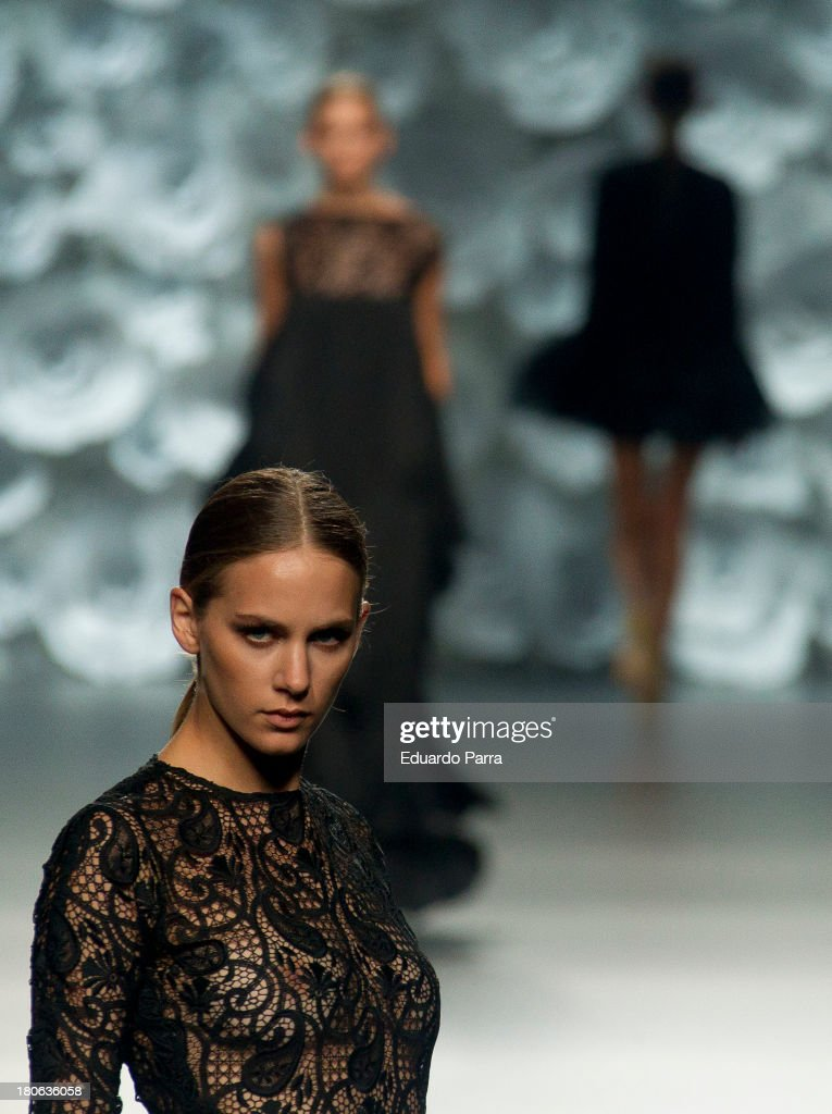 Models showcases designs by Juana Martin on the runway at Juana Martin show during Mercedes Benz Fashion Week Madrid Spring/Summer 2014 on September 15, 2013 in Madrid, Spain.