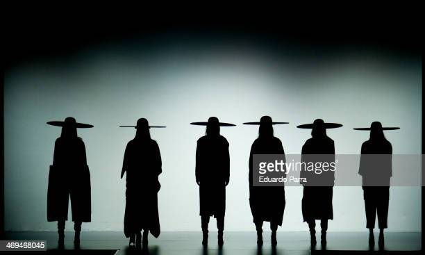 Models showcases designs by Martin Lamothe on the runway at Martin Lamothe show during Mercedes Benz Fashion Week Madrid Fall/Winter 2014 at Ifema on...