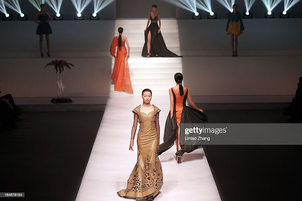 Models showcases designs on the catwalk during Hempel Award the 21st China International Young Fashion Designers Contest on the second day of Mercedes-Benz China Fashion Week Autumn/Winter 2013/2014 at Banquet Hall of Beijing Hotel on March 25, 2013 in Beijing, China.