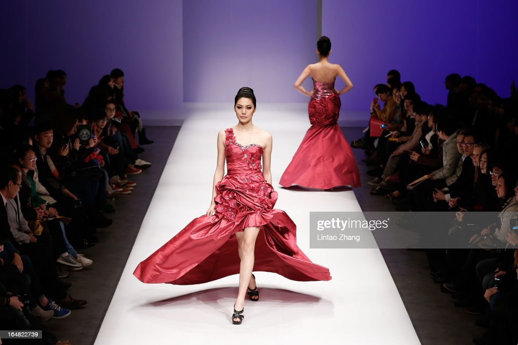 Models showcases designs on the catwalk during LU Classic Lu Weixing Dress Collection on the fifth day of Mercedes-Benz China Fashion Week Autumn/Winter 2013/2014 at 751 D.PARK Central Hall on March 28, 2013 in Beijing, China.