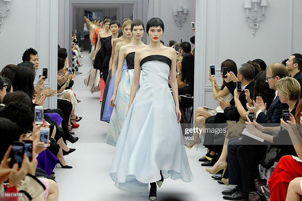 Models showcases designs on the catwalk during the Christian Dior S/S 2013 Haute Couture Collection at Five on the Bund on March 30, 2013 in Shanghai, China.