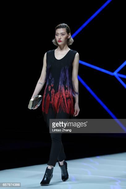 A models showcases designs on the runway at Ashei Kasei Chinese Fashion Designer Creativity Award Tom Dong Show during the MercedesBenz China Fashion...