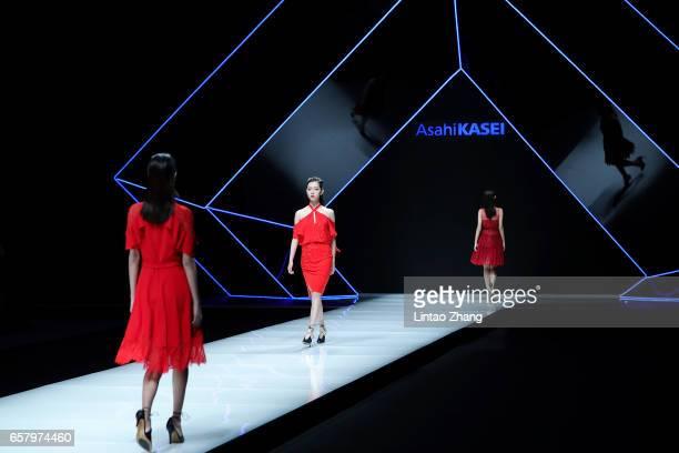 Models showcases designs on the runway at Ashei Kasei Chinese Fashion Designer Creativity Award Tom Dong Show during the MercedesBenz China Fashion...