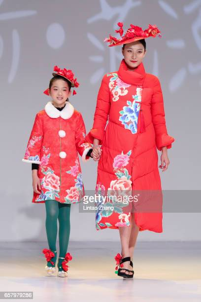 Models showcases designs on the runway at Designer Fan Chung works released Show during the MercedesBenz China Fashion Week Autumn/Winter 2017/2018...