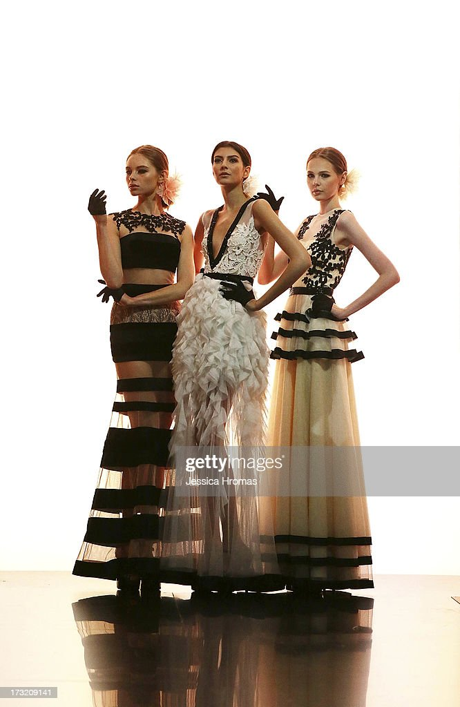 Models showcases designs on the runway during the Gregorius Vici show on day 3 of Hong Kong Fashion Week Spring/Summer 2013 at the Hong Kong Convention and Exhibition Centre on July 10, 2013 in Hong Kong, China.