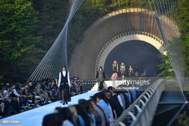 Models showcases the design on runway during the Louis Vuitton Resort 2018 show at the Miho Museum on May 14 2017 in Koka Japan