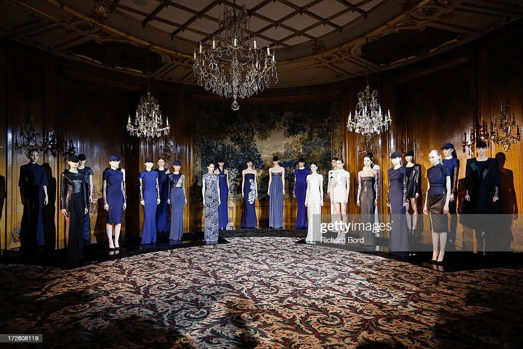 Models stand on the runway during the Didit Hediprasetyo show as part of Paris Fashion Week Haute-Couture Fall/Winter 2013-2014 at Hotel Le Bristol on July 4, 2013 in Paris, France.