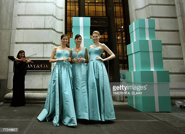 Models stand outside the entrance to the new Wall Street store of Tiffany Co during the opening ceremony 10 October 2007 The store located at 37 Wall...