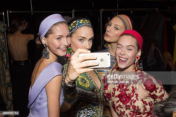 Models take a selfie after the Naeem Khan fashion show during Spring 2016 New York Fashion Week at The Arc Skylight at Moynihan Station on September...