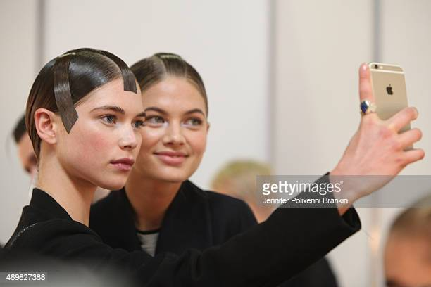 Models take a selfie backstage ahead of the Haryono Setiadi show at MercedesBenz Fashion Week Australia 2015 at Carriageworks on April 14 2015 in...