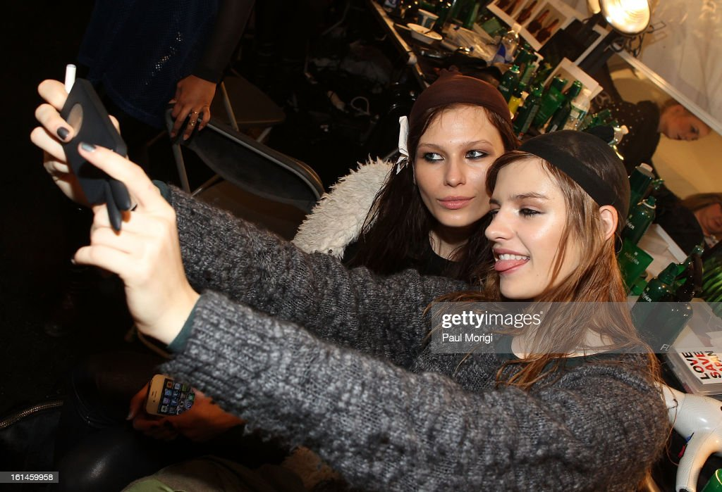Models take a self-portrait backstage at ICB By Prabal Gurung during Fall 2013 Mercedes-Benz Fashion Week at The Studio at Lincoln Center on February 11, 2013 in New York City.